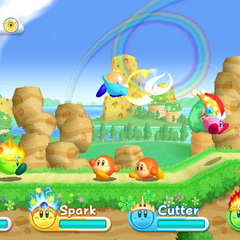 Cuatro Kirbys jugando en cooperativo.