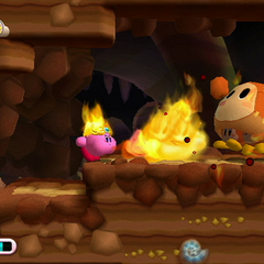Kirby usando su habilidad Fuego.