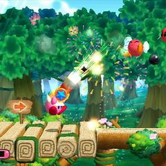 Kirby usando un cañón contra varios Bronto.