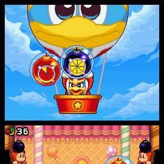 Varios Kirbys luchando contra el Rey Dedede y sus secuaces.