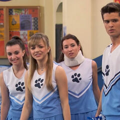 Adam, Stephanie and the cheerleading squad looking at Bree
