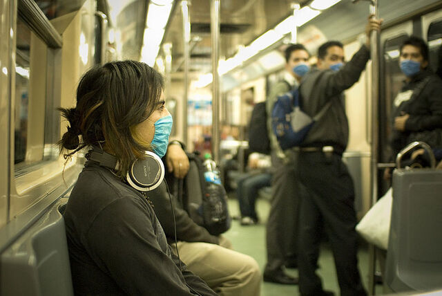File:Swine flu masked train passengers in mexico.jpg
