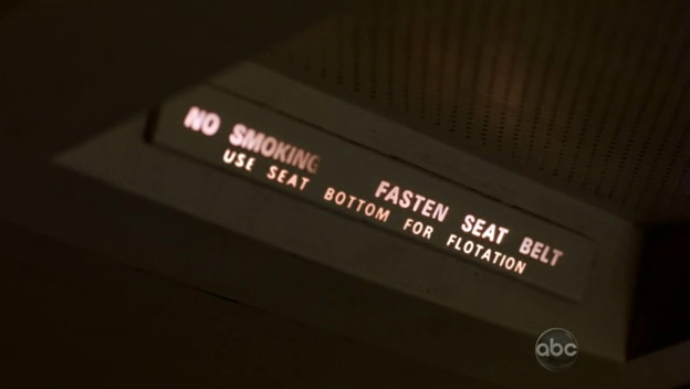 File:5x06-fasten-seat-belt-warning-flight-316.png