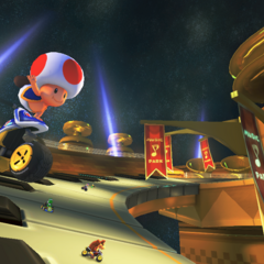 Toad, and several other characters, racing on the track.