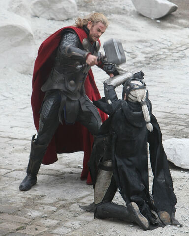 File:Thor-dark-world-chris-hemsworth-hitting-christopher-eccleston-malekith.jpg