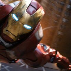 Iron Man flying through the city.