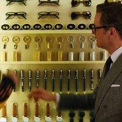 Eggsy looking in a room of Kingsman accessories