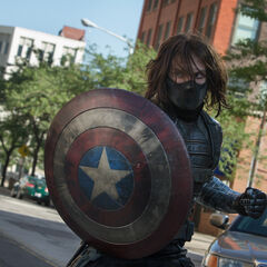 Winter Soldier wielding Cap's shield in <i>The Winter Soldier</i>