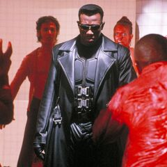 Blade interrupts a group of vampires during a blood party.