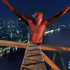 Spider-Man leaps off the bridge to save  Mary Jane and the children.