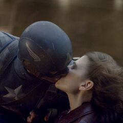 Peggy kisses Captain America.