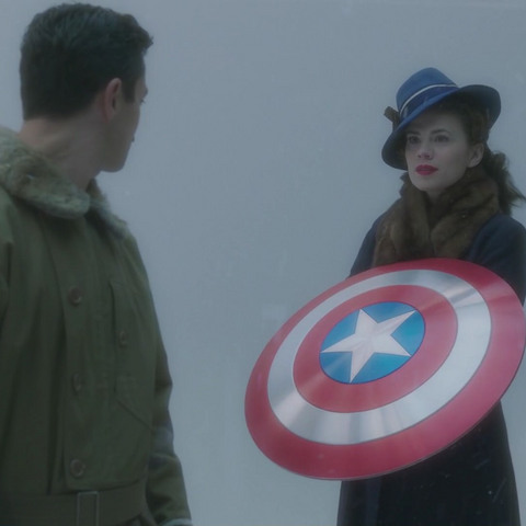 Peggy Carter with Captain America's Shield