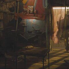 Banner entering a shack.
