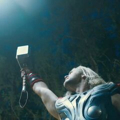 Thor summoning lightning.