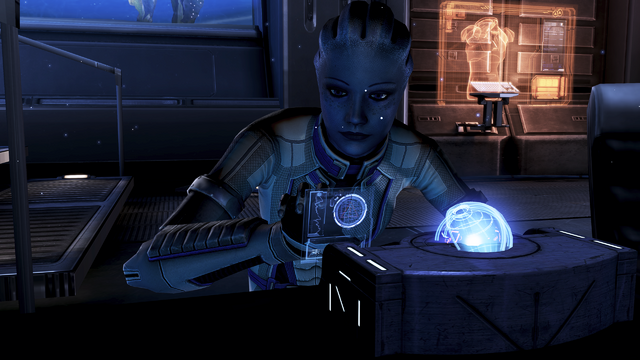 File:Liara programming the glyph capsule.png