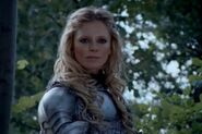 Morgause kara şövalyelerine bakıyor