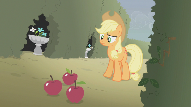 File:Applejack looking at three apples on the ground S2E01.png