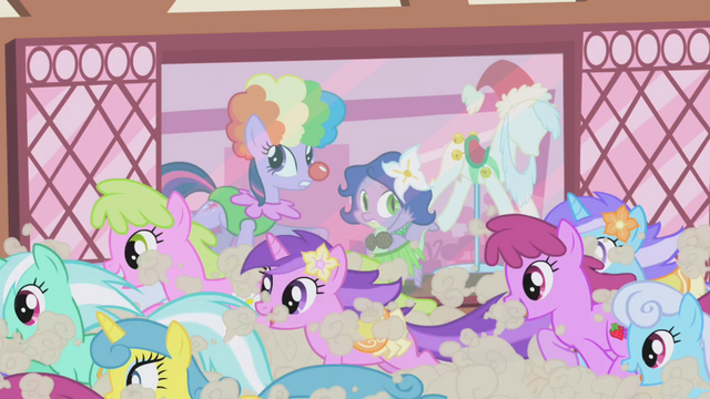File:Ponies run past costume shop S1E3.png