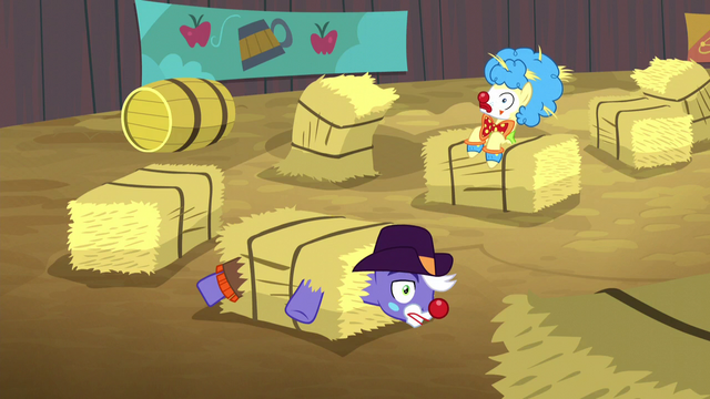 File:Rodeo clowns stuck in hay bales S5E6.png