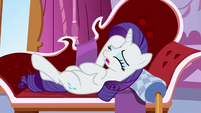 Rarity lying back on her couch S6E22