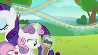 Rarity carrying fringe away; Sweetie annoyed S6E14