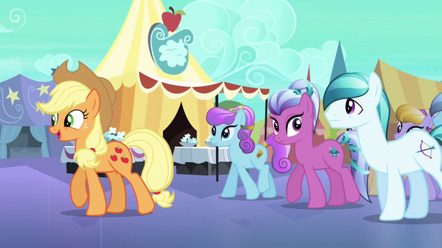File:Applejack guides Crystal Ponies through the Faire S3E01.png