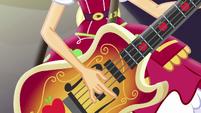 Applejack strumming her bass guitar EG4