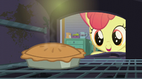 Apple Bloom opens a stove containing a pie S6E4