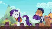 Rarity approaches the ship with a porter pony S6E22