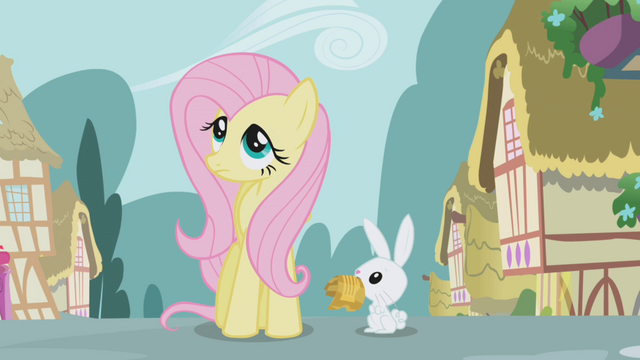 File:Angel looks at Fluttershy while holding the tickets S1E03.png