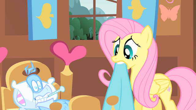 File:Fluttershy taking care of Philomena2 S01E22.png