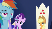 Rainbow, Starlight, and AJ looking at Spike S6E1