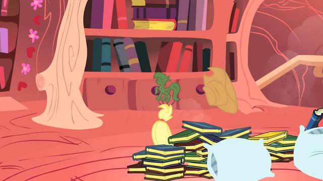 File:Applejack under pile of books S1E08.png