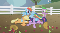 Rainbow Dash crash-lands into Applejack and Twilight S1E03