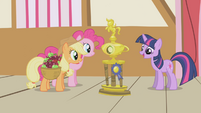 Applejack and Pinkie gazing at the trophy S1E04