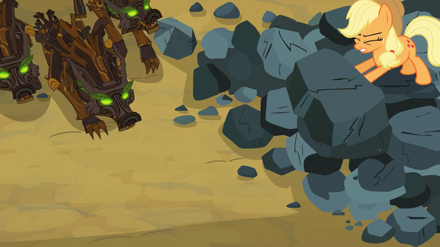 File:Applejack pushing boulder on timberwolves S03E09.png