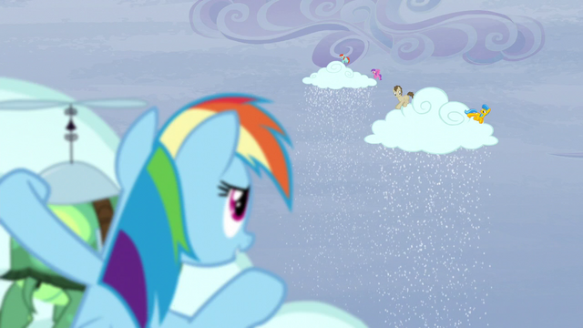 File:Rainbow behind a cloud sees ponies making the clouds snow S5E5.png