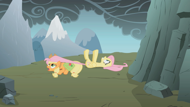 File:Applejack dragging Fluttershy S1E07.png