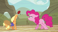 Applejack bucking the ball with one hoof S6E18