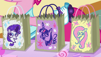 Rarity, Twilight, and Fluttershy's candy bags S5E21