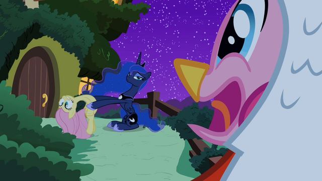 File:Pinkie Pie looking at Luna holding Fluttershy S2E04.png