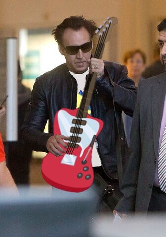 File:FANMADE Nicolas Cage holding guitar.jpg