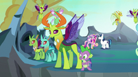 Thorax and Spike watch Queen Chrysalis fly away S6E26
