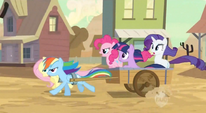Five main ponies chasing Applejack in a cart S2E14