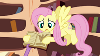 Spike about to take the book S3E05