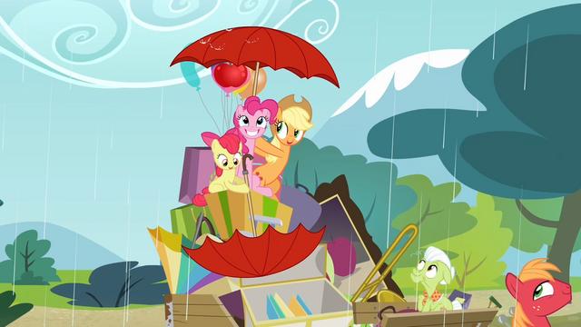 File:Applejack points umbrella upwards while Apple Bloom points umbrella downwards S4E09.png
