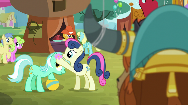 File:Sweetie Drops putting flower on Lyra's head S5E11.png