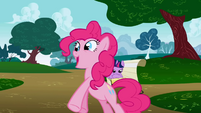 Pinkie Pie standing with her hooves out S1E5