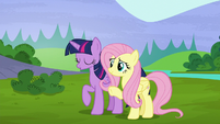 Twilight relieved; Fluttershy waving goodbye S5E23
