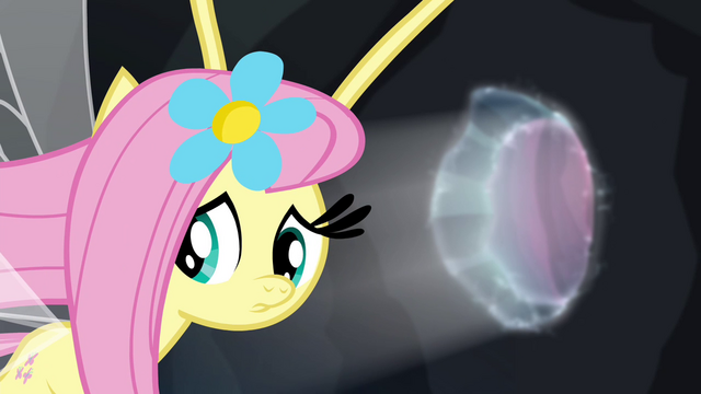 File:Fluttershy looking behind one last time S4E16.png